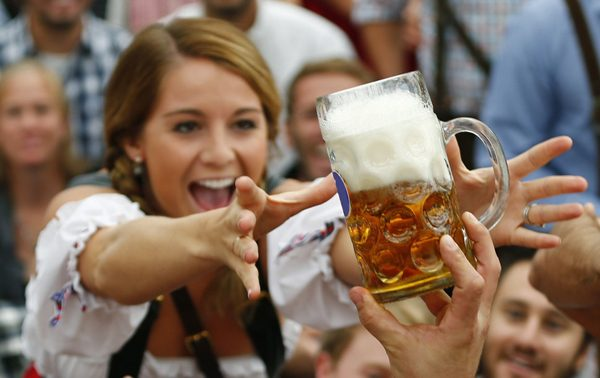 A visitor reaches for of the one of the first mugs of beer during opening ceremony for 180th Oktoberfest in Munich